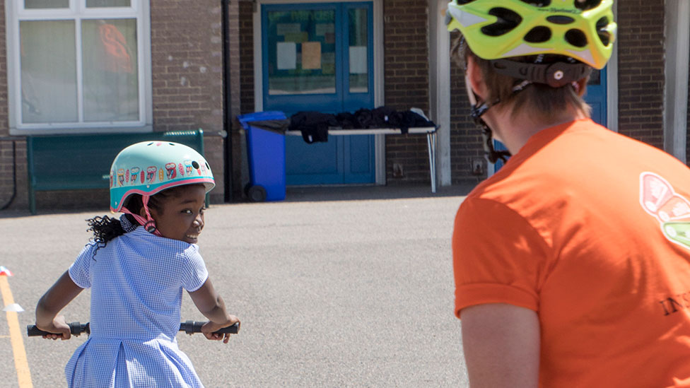 Girl getting Bikeability training